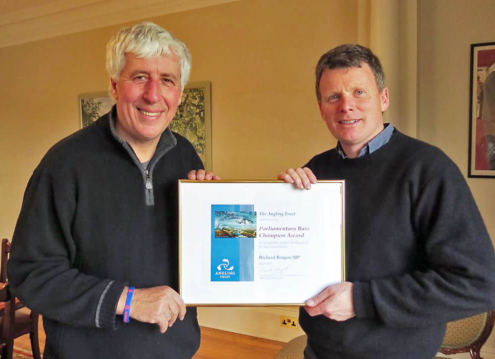 Angling Trust's Martin Salter presents Richard Benyon MP with his certificate