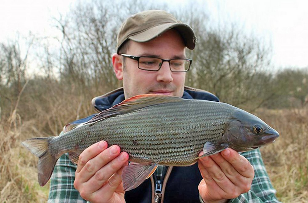 Darren Clarke with a 2.03 grayling