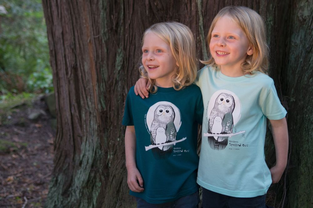 $1  for One.  Support the extraordinary work of the Wilderness Committee by purchasing a SpeeZees Northern Spotted Owl t-shirt in Ocean or Deep Sea.