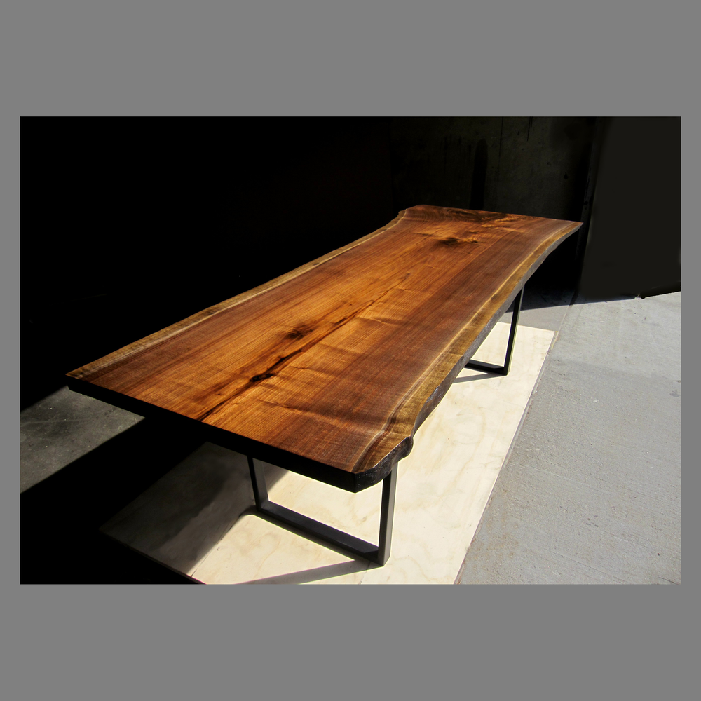 walnut slab dining table with black steel base