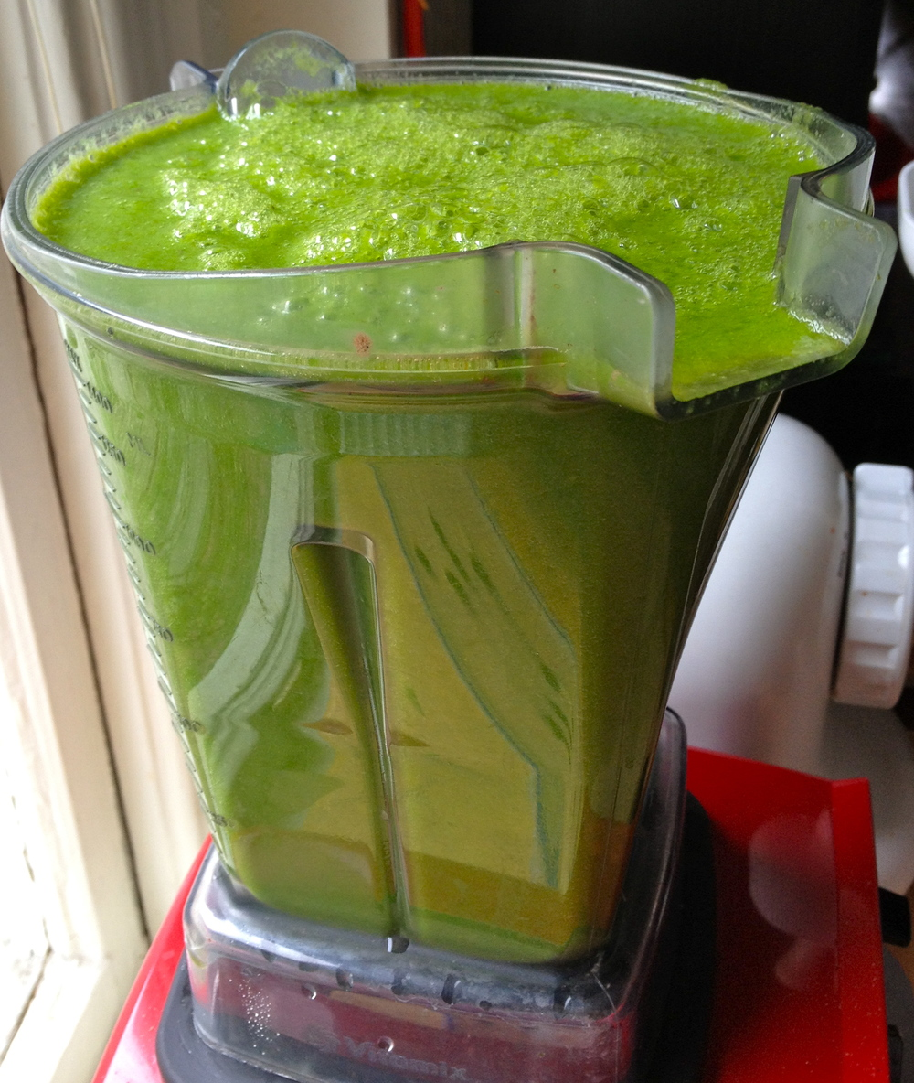 A high-powered blender makes all the difference when blending fibrous greens. Green smoothie with romaine lettuce, cucumber, celery, lemon, apple, and banana.