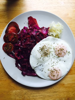 Typical breaky - three eggs, braised red cabbage, tomatoes, and of course kraut