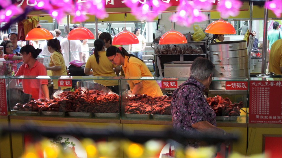 Inside a Singapore Hawker Centre.  Foodable Web TV |  Photo Credit: BBC News