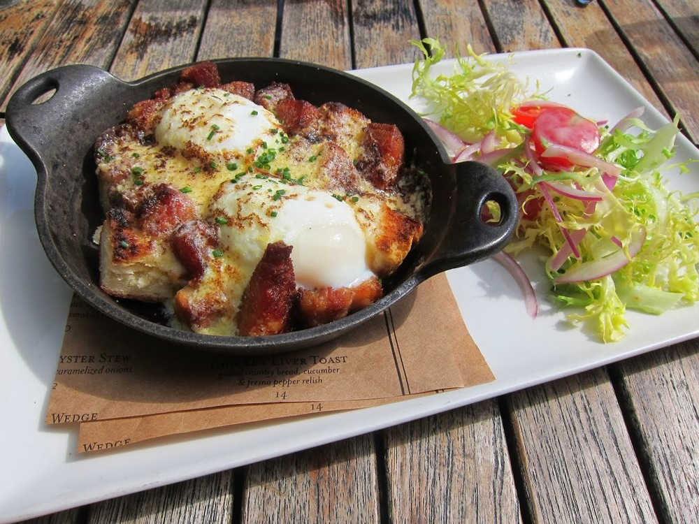 BLT Benedict Cast Iron Casserole - Buttermilk biscuit crumble, soft poached organic egg, house-cured bacon, cherry tomato salad, frisee, Hollandaise
