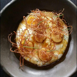 Pictured: Potato polenta, bone marrow, fried flank steak  | Photo Credit: Michael Voltaggio//Twitter