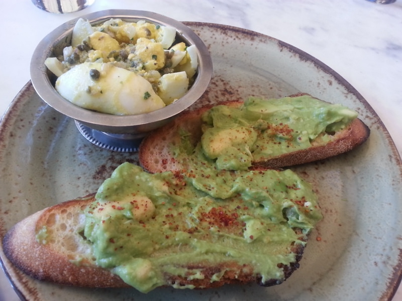 Avocado toast with espelette pepper, boiled egg gribiche at Eveleigh  | Foodable WebTV Network