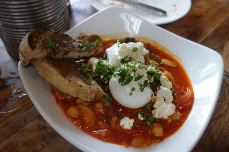 Poached egg, harissa piperade, braised garbanzos, chard, date toast at M.B. Post  |  Foodable WebTV Network