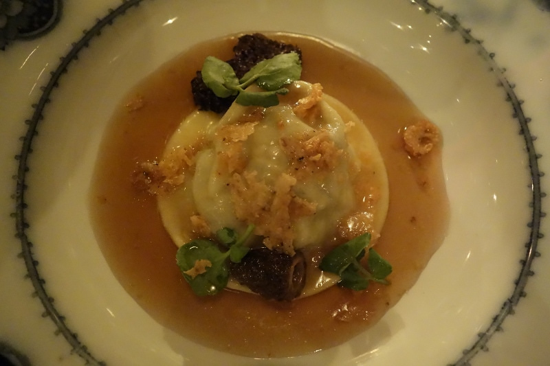Raviolo with consommé, truffle crumble, and watercress at Maude | FOODABLE WEBTV NETWORK