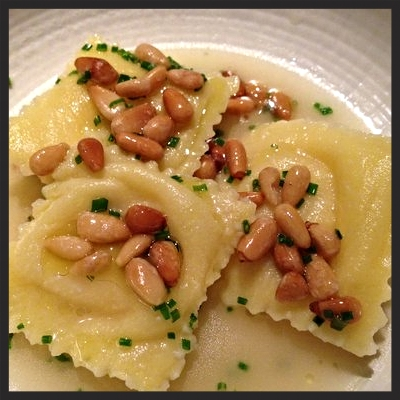 Mushroom custard ravioli with toasted pine nuts in a buttery broth at Serpico  | YELP, Bryce Q.
