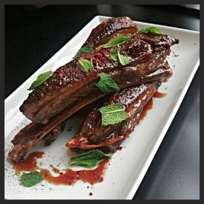Baharat spiced lamb ribs, pomegranate molasses, mint and marash pepper at Levant  | Facebook, Levant