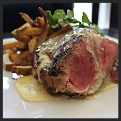 7 ounce sirloin, porcini butter, herbed house-cut fries and béarnaise at Brass Union  | Twitter, @BrassUnion