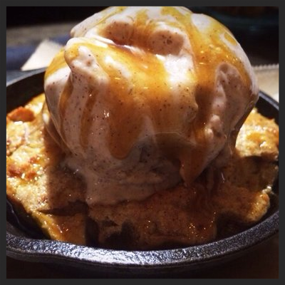 Apple bread pudding with cinnamon ice cream and bourbon caramel at Work & Class | YELP, Oanh P.