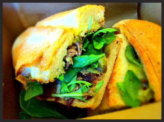 Pepito Torta: Beer-braised Beef Short Ribs, pickled Jalapeños, Chihuahua Cheese, Black Beans, Cilantro Crema & Arugula at Tortas Frontera at Chicago O'Hare  | YELP, D K.