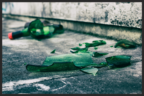 Shattered wine bottle on ground