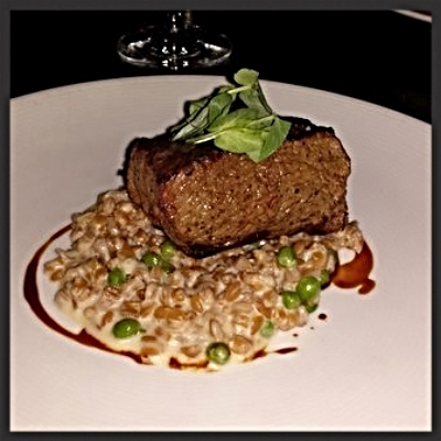 "Angus rib eye with english pea ""risotto"" at Bourbon Steak 