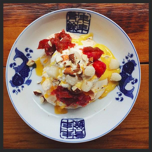 Rhubarb pavlova, ginger rhubarb compote, orange curd, maple whip & mochi at Mei Mei. | Credit: Instagram, meimeiboston
