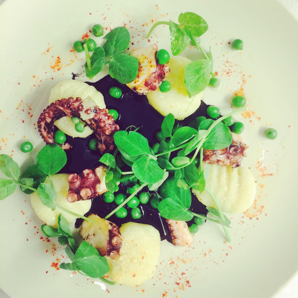Octopus with squid ink emulsion, fresh peas & pea shoot at After Peacock Room  | Courtesy of Chef Sebastien Rondier