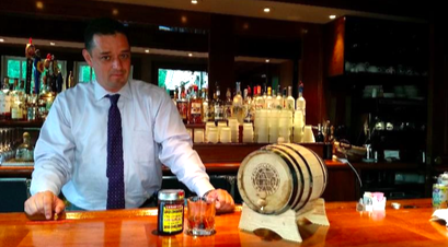 J.C. Mejia with Aspetuck's house-aged bourbon cask and cocktail