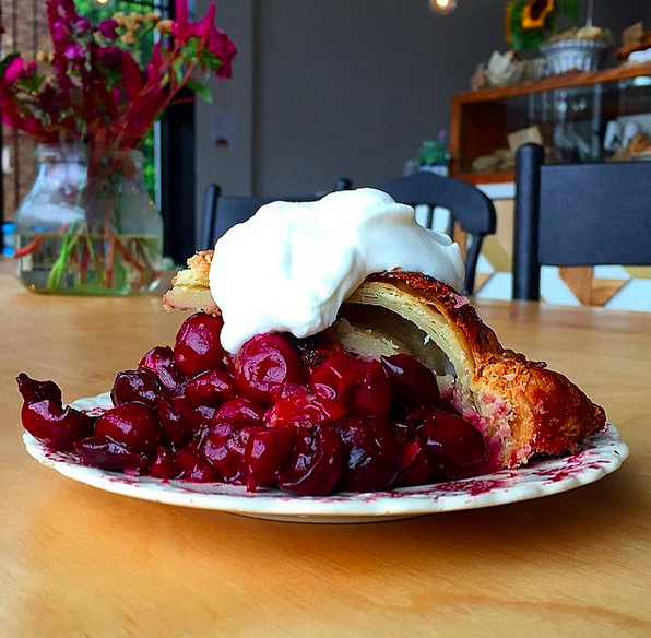 A slice of sour cherry bourbon pie | Instagram, @bill_addison