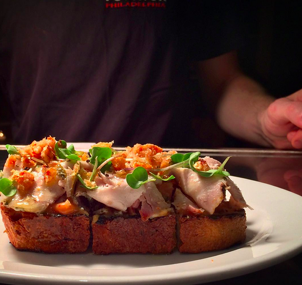 Porchetta on toast with peach mustard & crispy skin  | Credit: Instagram @vernickphilly