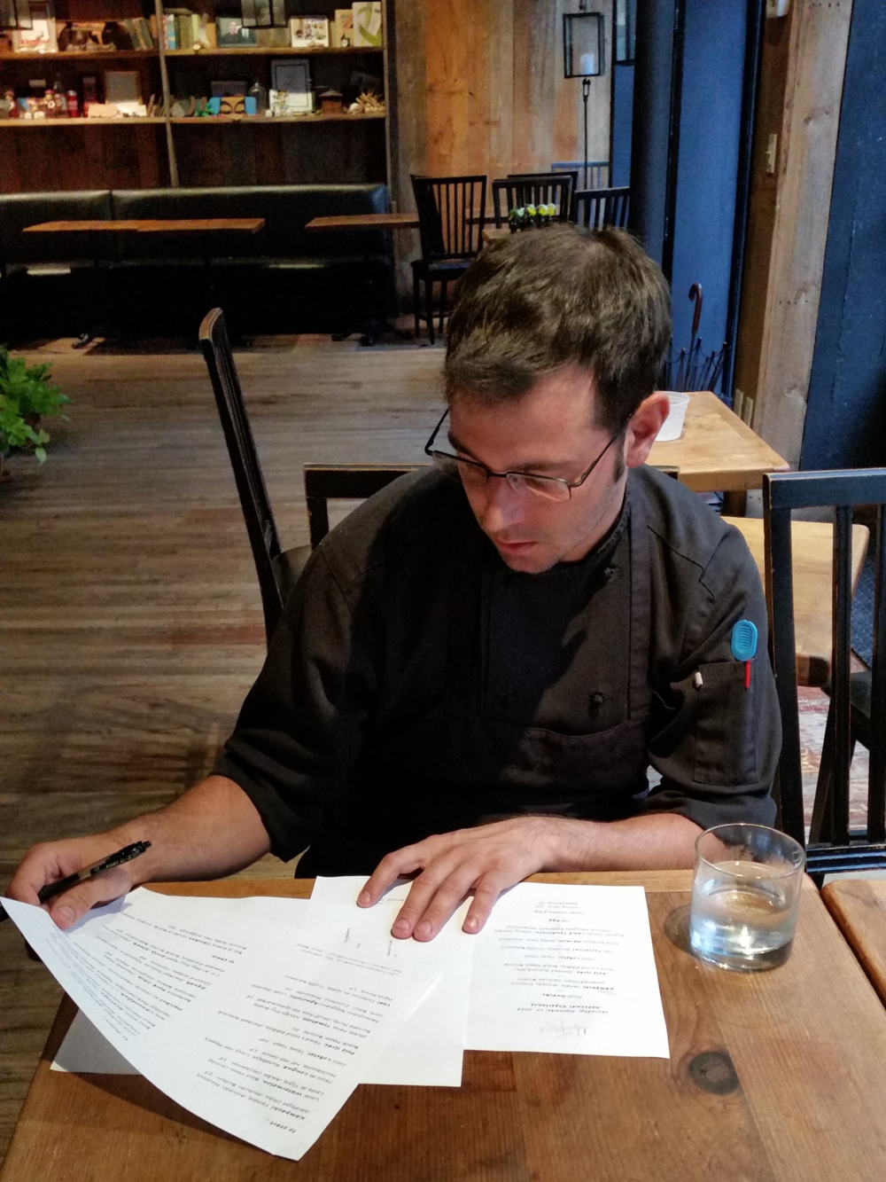 Chris looking over the night's menu | Erica Nonni for Foodable Network