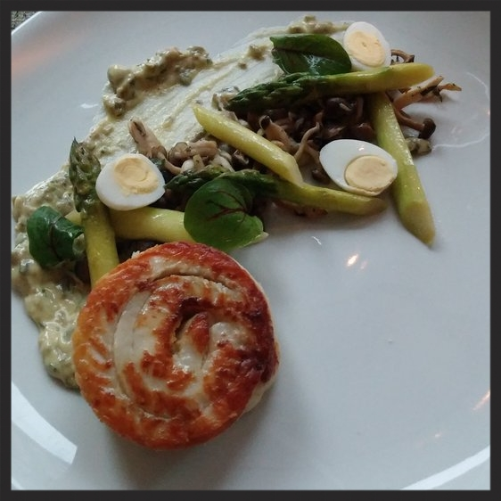 Flounder with quail eggs, asparagus, and mushrooms at Liquid Art House | Credit: Yelp, Kailey O.