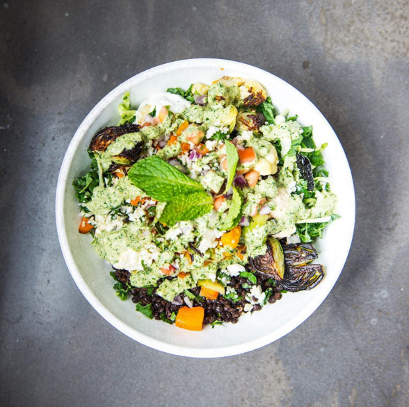 Supergreens, black lentils, tzatziki, crazy feta, roasted veggies, tomato & onion, pickled banana peppers, mint & lemon-herb Tahini  | Instagram @cavagrill