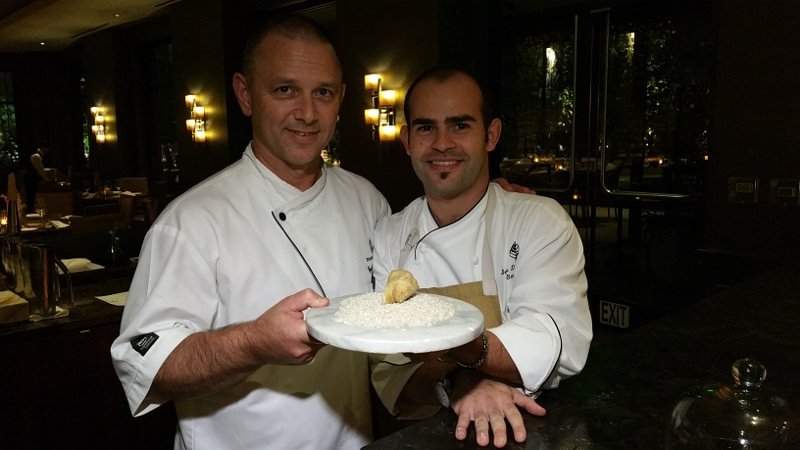 Chefs Cyrille Pannier and Denis Dello Stritto of the Four Seasons in L.A. hold a prized white truffle | Allison Levine for Foodable WebTV Network