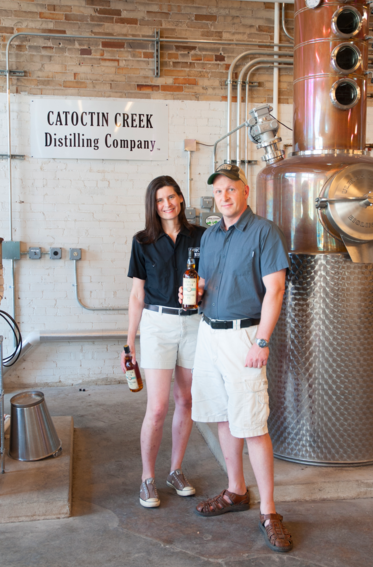 Scott and Becky Harris stand next to one of their stills in their production room in Virginia. | Credit: Kristen Dill
