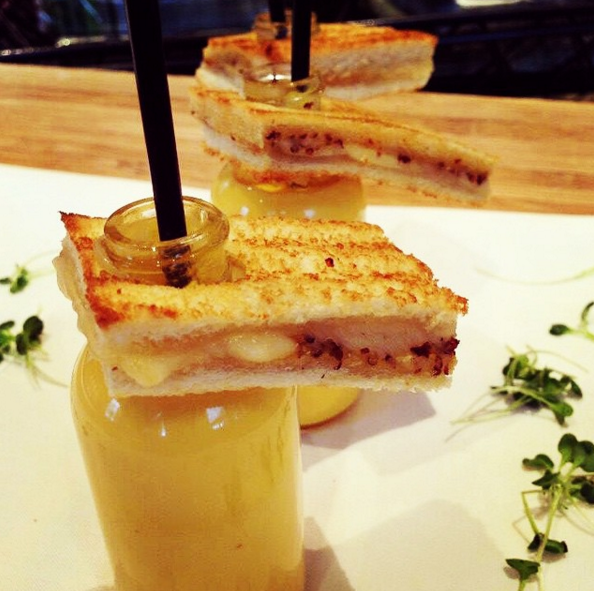 For National Grilled Cheese Day, Cutting Edge Cuisine served grilled cheese with bottles of soup | Credit: Instagram @cec_food