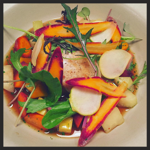 Golden Tilefish with country ham broth under all these winter greens and vedge at The Dabney | Instagram @thedabneydc