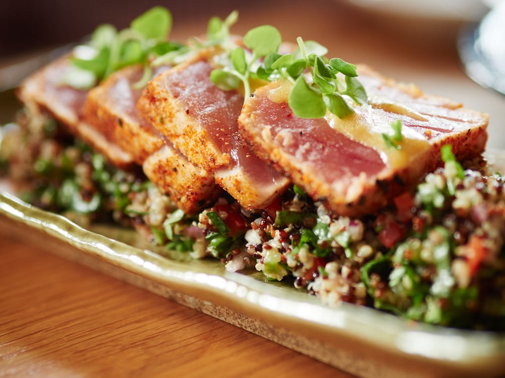 Quinoa Tabbouleh: tuna tataki, fresh herbs, quinoa, bell peppers, cucumber, red onions, ginger vinaigrette | Photo Courtesy of the Centurion Restaurant Group