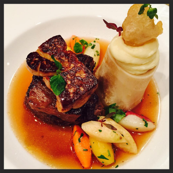 Pot au feu with braised short rib, roasted tenderloin, seared foie gras, root vegetables, beef consommé, horseradish pomes purée, and fried bone marrow | Instagram