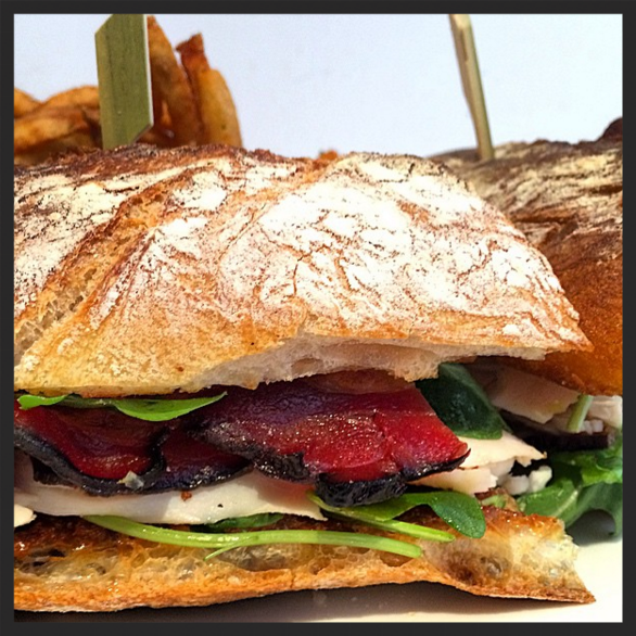 House roasted turkey sandwich with applewood smoked bacon, arugula, jalapeños at ABC Kitchen  | Instagram @abckitchen