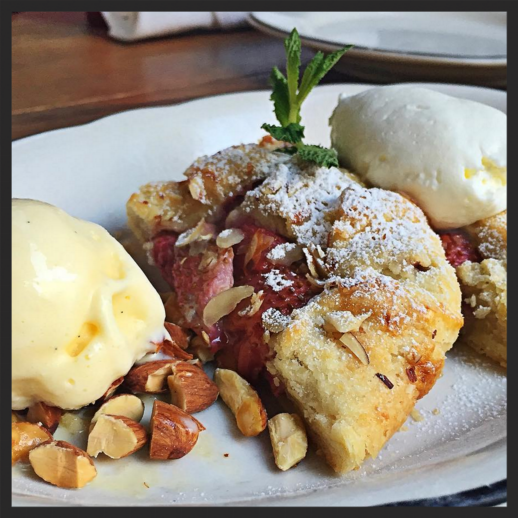 Strawberry frangipane crostata topped with toasted almonds and house-made corn ice cream  | Instagram @michaelsgenuine