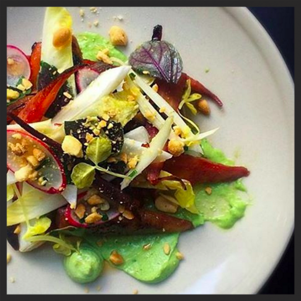 Charred baby carrots, green goddess dressing, endive, and peanuts at Aldine Restaurant | Instagram @aldinephilly