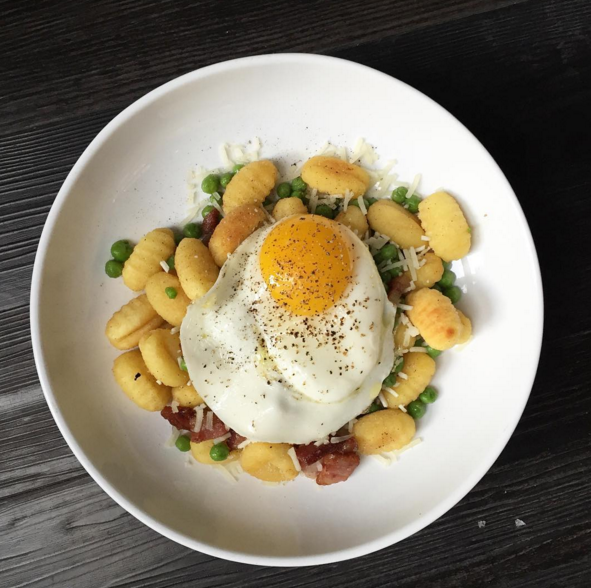 An egg atop gnocchi at Bar Toma  | Instagram, @bartomachicago