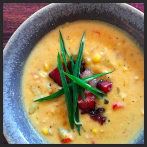 Corn chowder with green onion and house smoked bacon at Michael's Genuine |  Instagram @michaelsgenuine