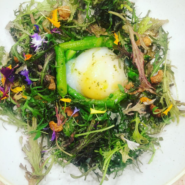 Asparagus, duck egg, mustard greens, and tarragon  |  Instagram @kalirestaurant