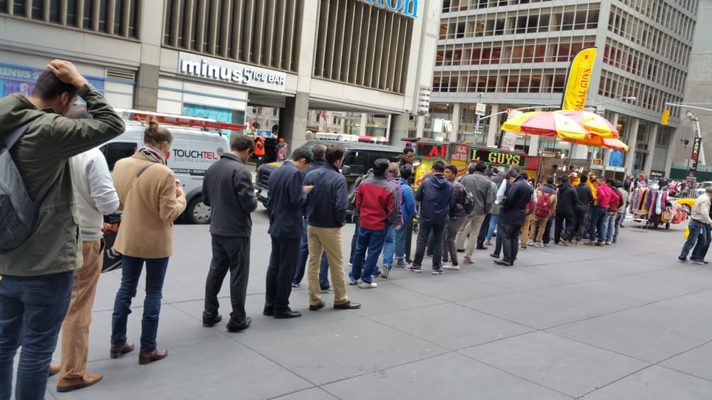 Guests wait in the long line to get The Halal Guys' grub | YELP