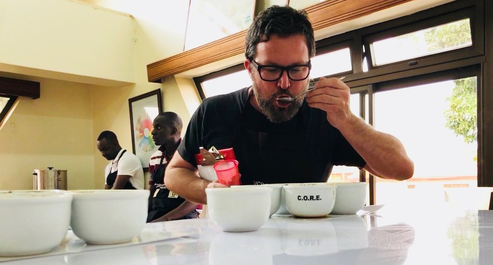 Joel Pollock is pictured cupping coffee for the Ugandan Coffee Development Authority coffee competition in Kampala, Uganda.