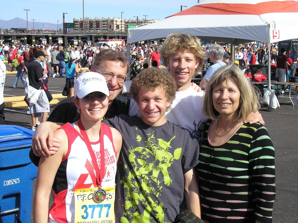 Anna with her family after completing her first marathon.