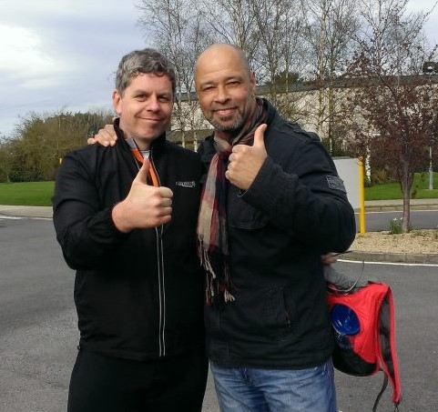 Mark Gilleran (left) after completing a 100k cycle, with former Ireland, Manchester United star and all-around legend Paul McGrath.