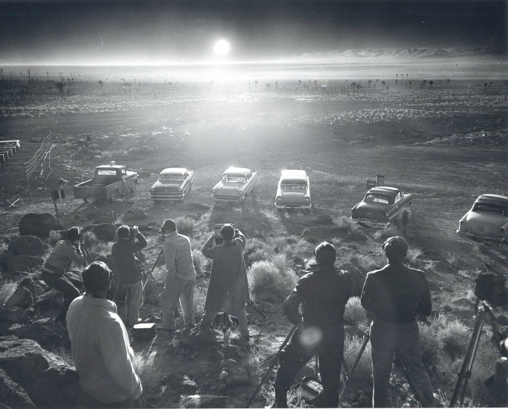 Photographers and reporters gather near Frenchman Flat to observe the Priscilla nuclear test; June 24, 1957