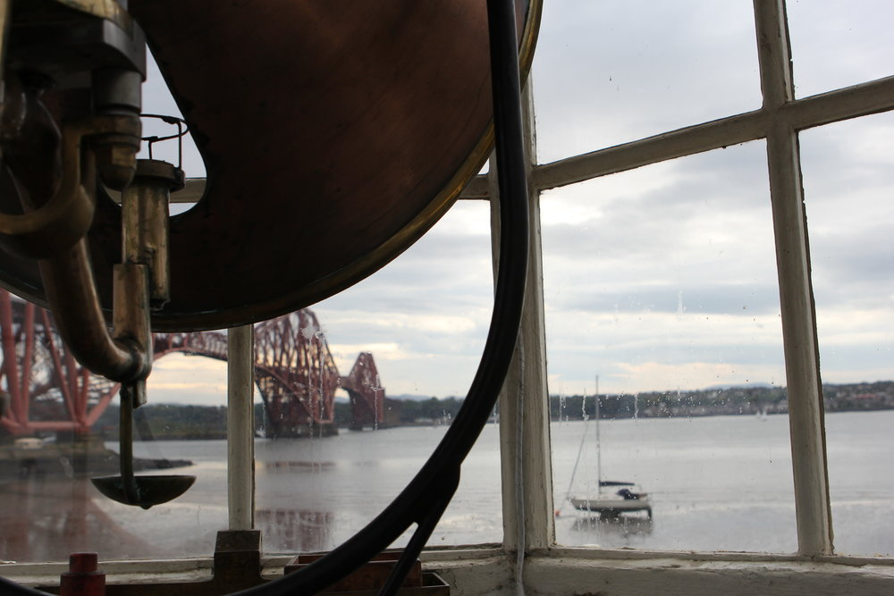 South Queensferry, Scotland. In the old lighthouse, Hawes Pier Bracon, looking at Forth Bridge. Both built in the 1800s.