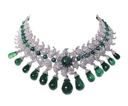 "Van Cleef & Arpels, Paris, 1949–50. The ""Baroda Set"" ordered by the Maharani of Baroda, ""The Indian Wallis Simpson"", wife of the Maharaja of Baroda. This impressive suite of jewellery was designed by Jacques Arpels for Sita Devi, the second wife of Maharaja Pratapsinh Gaekwad of Baroda. It consists of 13 pear-shaped Colombian emeralds – 154 carats in total – suspended from diamonds set in the shape of a lotus flower. All the gems were all supplied by the Maharani and belonged to the Baroda Crown Jewels."