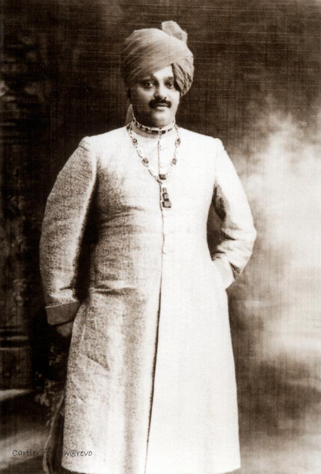 Maharajah of Nawanagar wearing the emerald and diamond necklace created by Cartier in 1926, Cartier Archives.