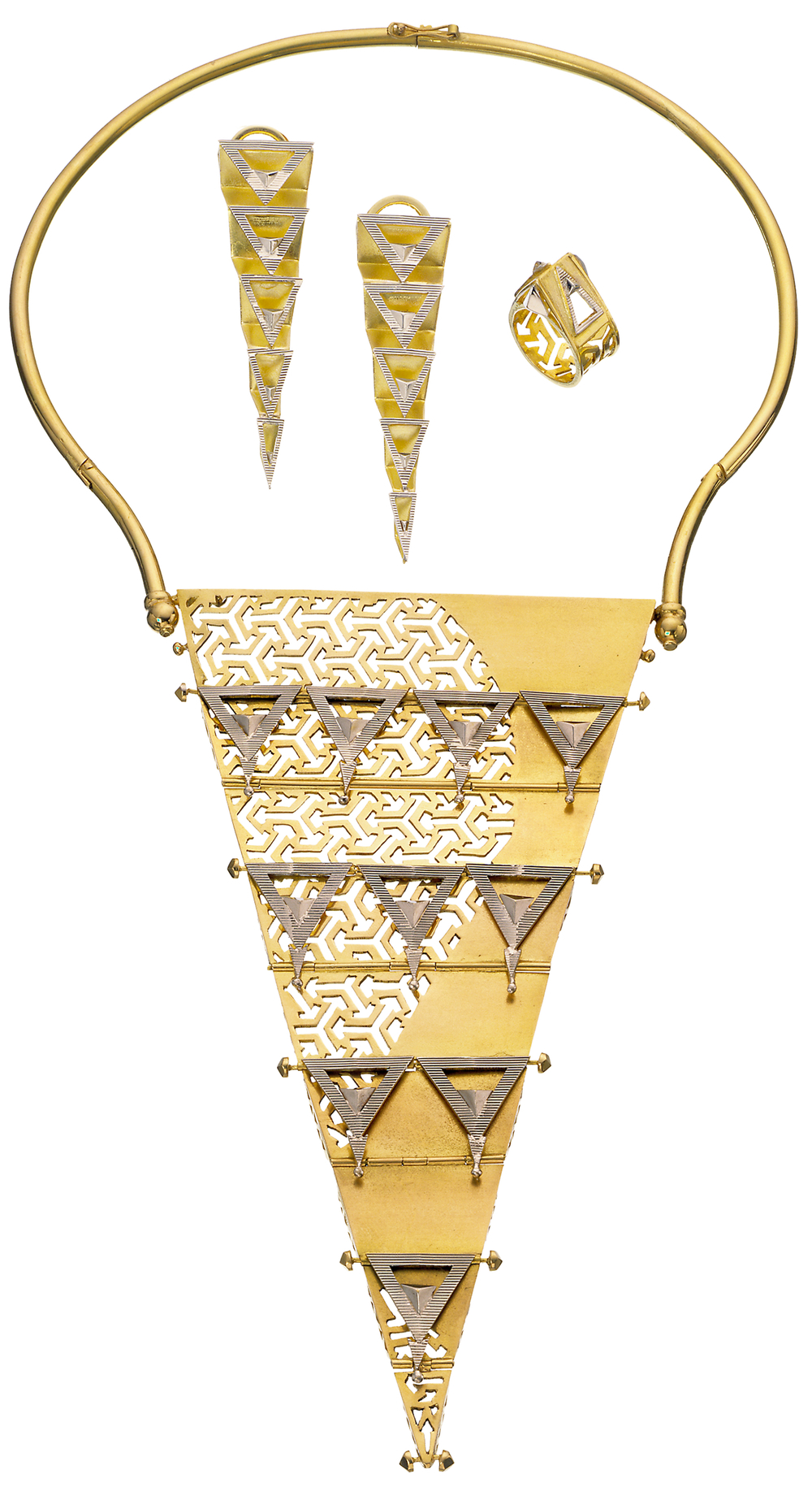 Image: 'Gold Virtuosi' ensemble by Reena Ahluwalia. 18K white and yellow gold. 12 inch necklace transitions from 2D to 3D. Composed of diagonal planer elements and triangles; each plate is hinged and folds like pleats to create a 3D form. Inspired by    Pragati Maidan   , a large convention center in New Delhi, India. The impression it left on me, resulted in a gold jewel. I found the interplay of open and closed spaces fascinating, as they almost assume human qualities. A meeting place, coming together of minds, blending and forming.