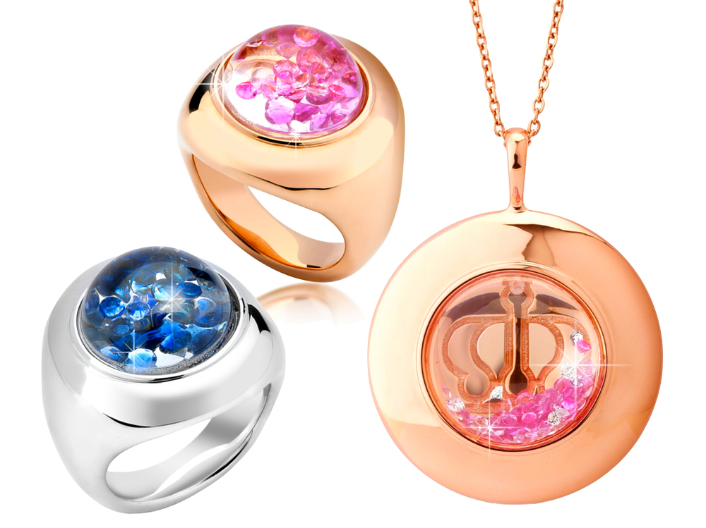 Shining Stars rings in 18K rose and white gold plated sterling silver with 0.80 ct pink and blue sapphires floating in globe. Pendant in 18K rose gold plated on silver with 1.72 ct. pink sapphires and 0.25 ct. diamonds in globe.