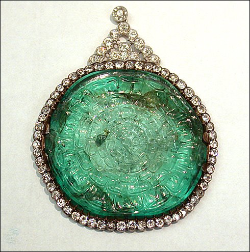This carved flat emerald is set in a platinum, gold, and diamond pendant necklace. The emerald was discovered in Colombia, possibly by Spanish conquistadors, and found its way to India for cutting. Smithsonian, photography by Ken Larsen.
